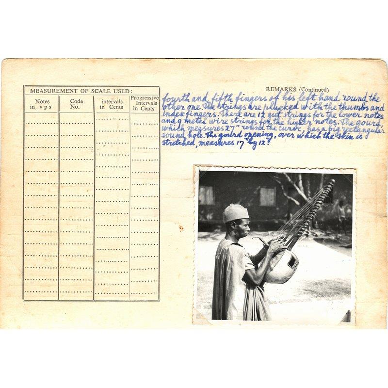 Mandingo praise song, preceded by tuning of Kora
